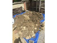 FREE TOPSOIL and MIXED SIZE RUBBLE from garden rockery.