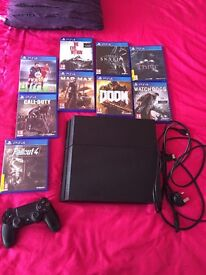 PlayStation 4 with 9 games ex condition
