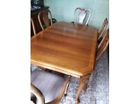 Rosewood Extendable Dining Table and 6 Chairs.