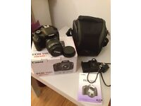 Canon EOS 550D Digital SLR Camera with 18-55 mm f/3.5-5.6 IS Lens Kit, and bag