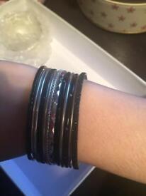 Black bracelets with charms
