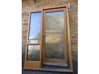 wooden front door (oak) with combination frame all glazing and chromed steel handles and letterboxs