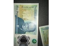 AK47 and AA010 £5 notes