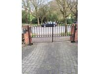 A pair of electric swinging iron wrought gates with 4 motors and 3 railings.