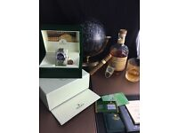 Silver Rolex Daytona with Black Face comes Rolex Bagged and boxed With Paperwork