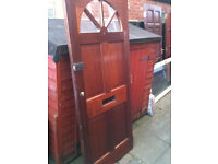 Exterior hardwood door with perspex halfcircle panels