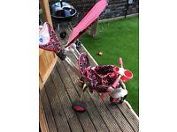 2 Kids smart trikes 1 red 1 pink