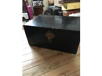 Black large trunk with brass fittings
