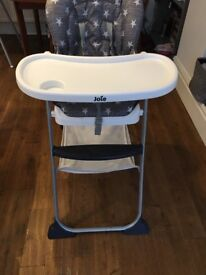Joie mimzy snacker highchair from newborn upwards. Reclines and has storage basket. 5 point harness.