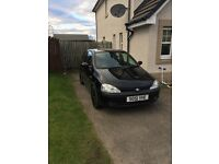 Black Vauxhall Corsa 1.2