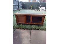 rabbit hutch , very little use , stored in garage . plus a large metal run .