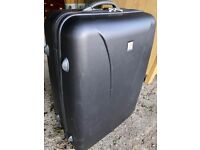 Big durable black suitcase with a heart of gold