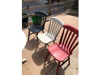 Round table with drop down sides to store close to a wall and 3 sturdy chairs
