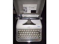 VINTAGE TYPEWRITER BY ADLER COMPLETE WITH INSTRUCTIONS IN VERY HEAVY METAL CASE