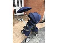 Stokke Xplory v4 travel system in Deep Blue, excellent condition