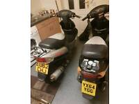 Two 50cc scooters running
