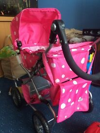 Pink and white spotty doll pram WITH Annabelle doll ***AS NEW***