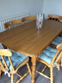 Solid wood dining table and 6 chairs. £80