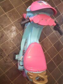 Girls frozen electric motor bike