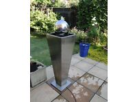 Garden fountain, stainles steel water feature.