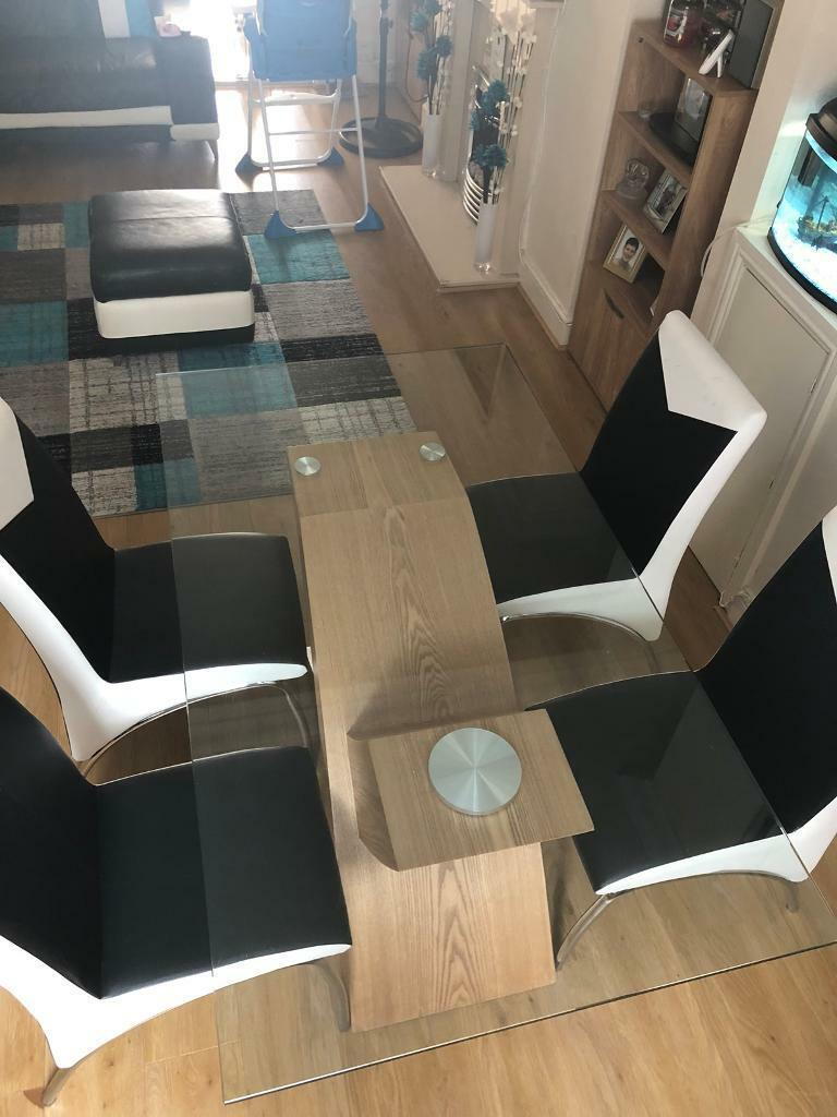 Dining table and chairs. glass leather