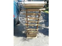 vintage wood rolling pin stand with 10 rolling pins on it as seen