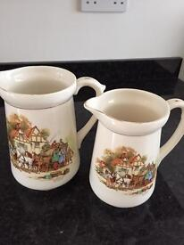 Pair of early Sylvac Falcon wear jugs .with coach and horses.