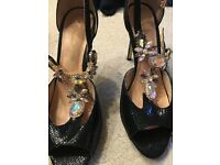Black jewelled shoes and matching bag.