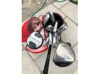 Set on golf clubs with bag and trolley