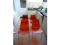 4 Dining Room chairs in Orange