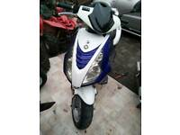 Baotian 125cc 4stroke moped. Reliable bike starts on the button.