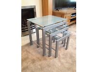 Set of three glass-top nesting coffee tables