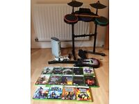 Xbox 360, 2 controllers, guitar, drums, mic + 14 games