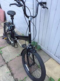 All black fold up bike