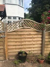 2 spare fence panels with curved top