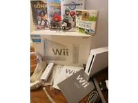 Nintendo Wii console with 4 games
