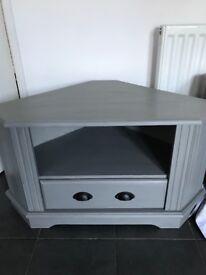 Lightly distressed corner TV cabinet in vintro cloudburst grey colour