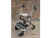 Invacare Banjo four wheel walker, locking brakes, seat with tray, good condition but no basket.