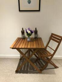 Foldable wooden table and chair