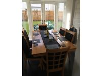 Solid oak dining table with 6 Chairs. Greatly reduced price due to slight wearing on table top.