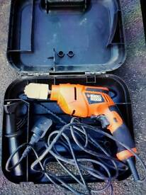 Black and decker hammer drill cased