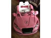 Pink ride on car been used twice so virtually brand new!!! Excellent condition!!!!