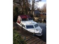 Microplus 571. 2 berth river cruiser boat.
