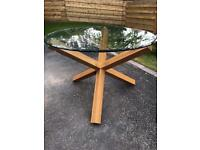 Round glass table with oak legs