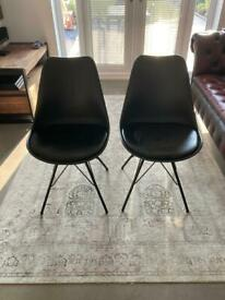 Four Black Chairs