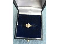 9ct gold, 0.25 carat diamond cluster engagement ring. Size L