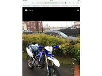 Very clean Wr 450f has years test new tyres good bike for the price