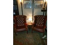 2 leather wing back chairs