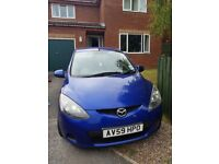 Blue Mazda2 TS2 diesel 1.4 four doors, a/c, CD player, remote controls on steering, 66089 miles