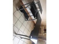 Black glass swivel computer desk with swivel chair